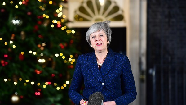 Theresa May returns to Brussels after surviving bruising confidence vote